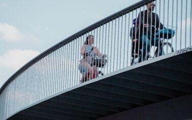Riconfigure - Cyclists on bridge